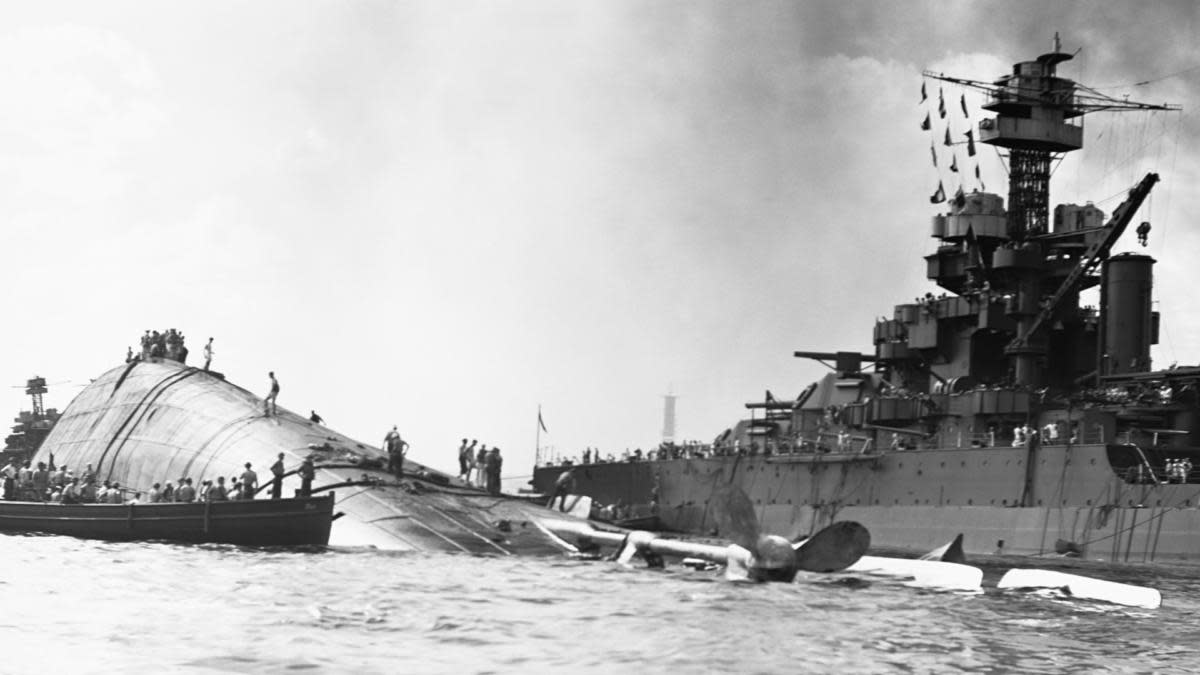 The USS Oklahoma floating capsized near the USS Maryland. (Credit: Corbis via Getty Images)
