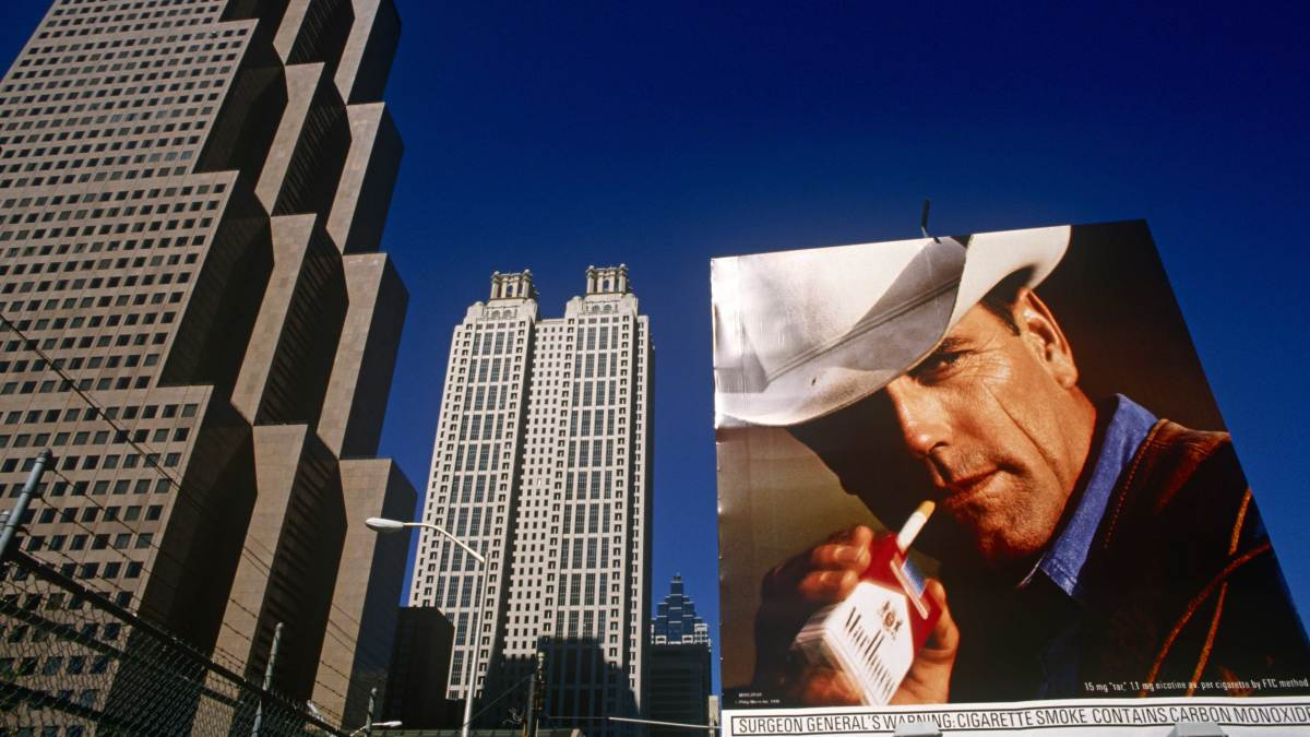 A Phillip Morris ad using the famous Marlboro Man cowboy character on a downtown Atlanta billboard. (Credit: In Pictures Ltd./Corbis via Getty Images)