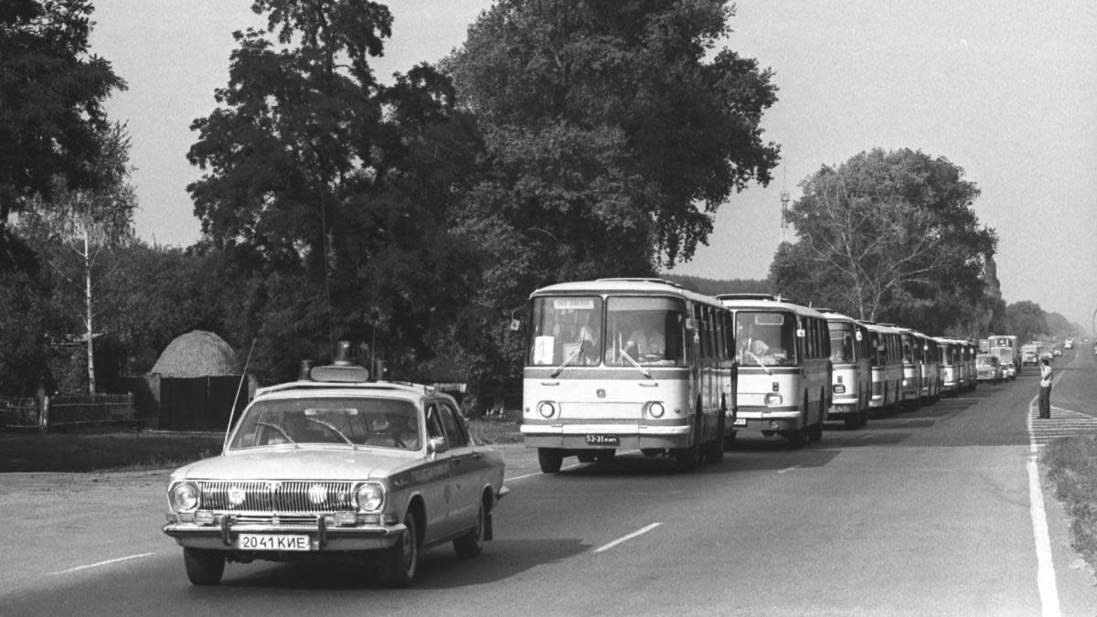 The evacuation of 47,000 inhabitants of Prypiat took place via 1,200 buses and 200 lorries. Locals were told to take few personal belongings and identity papers, to quickly evacuate as it was thought they would be returning several days later, which was not the case. The buses spread radiation to other locations. (Credit: Igor Kostin/Sygma/Getty Images)