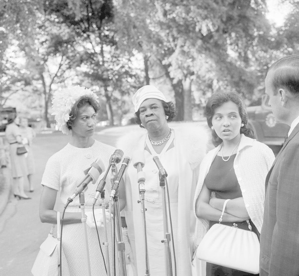 Gloria Richardson, Dr. Rosa L. Gragg and Diane Nash being interviewed after attending the White House to meet with President John F. Kennedy. He had asked 300 representatives of Women's organizations to back his civil rights program to help solve the racial problems. (Credit: Henry Burroughs/AP Photo)