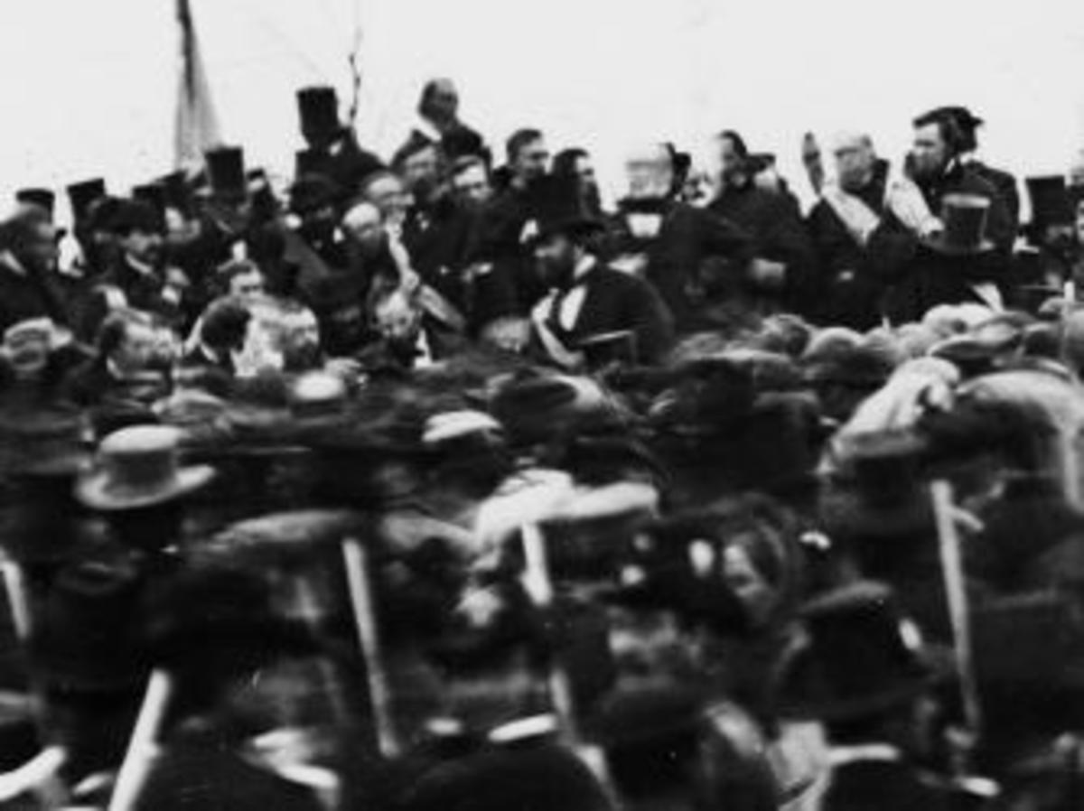 One of the only known photographs of Lincoln at the Gettysburg ceremony. He is bareheaded and facing the camera, to the left of the man with the beard and hat. (Library of Congress)