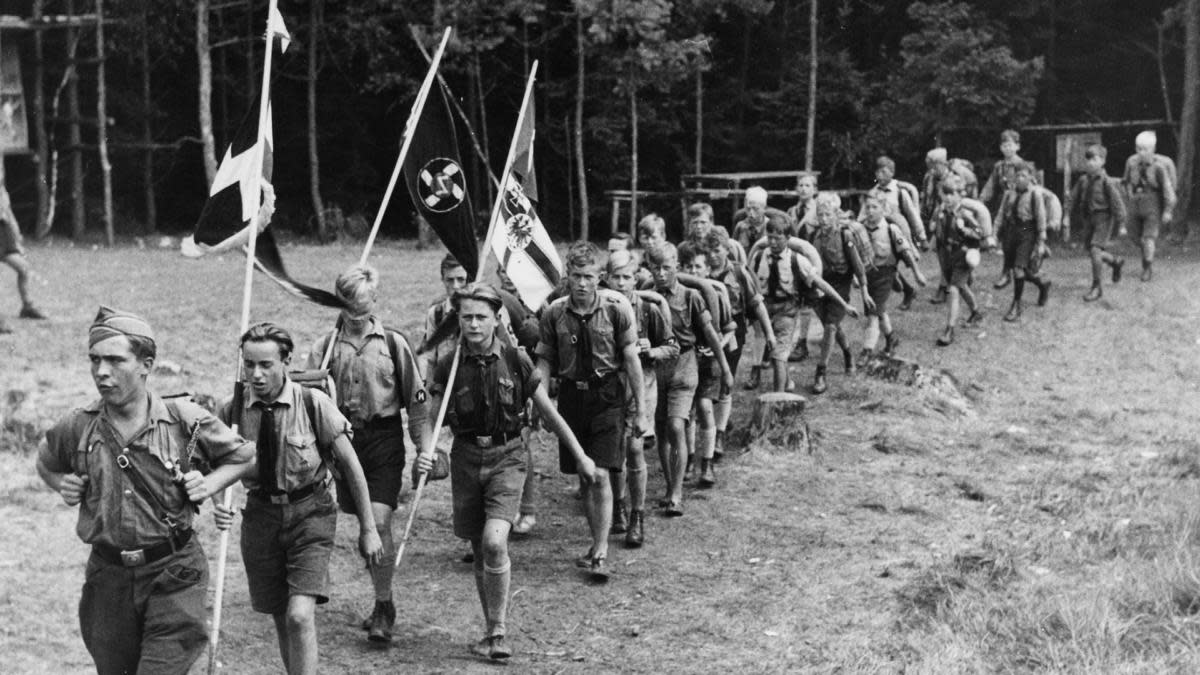 A group of boys leaving camp for a hike at a Hitler Youth summer camp in Berlin, 1933. (Photo by ullstein bild/ullstein bild via Getty Images)