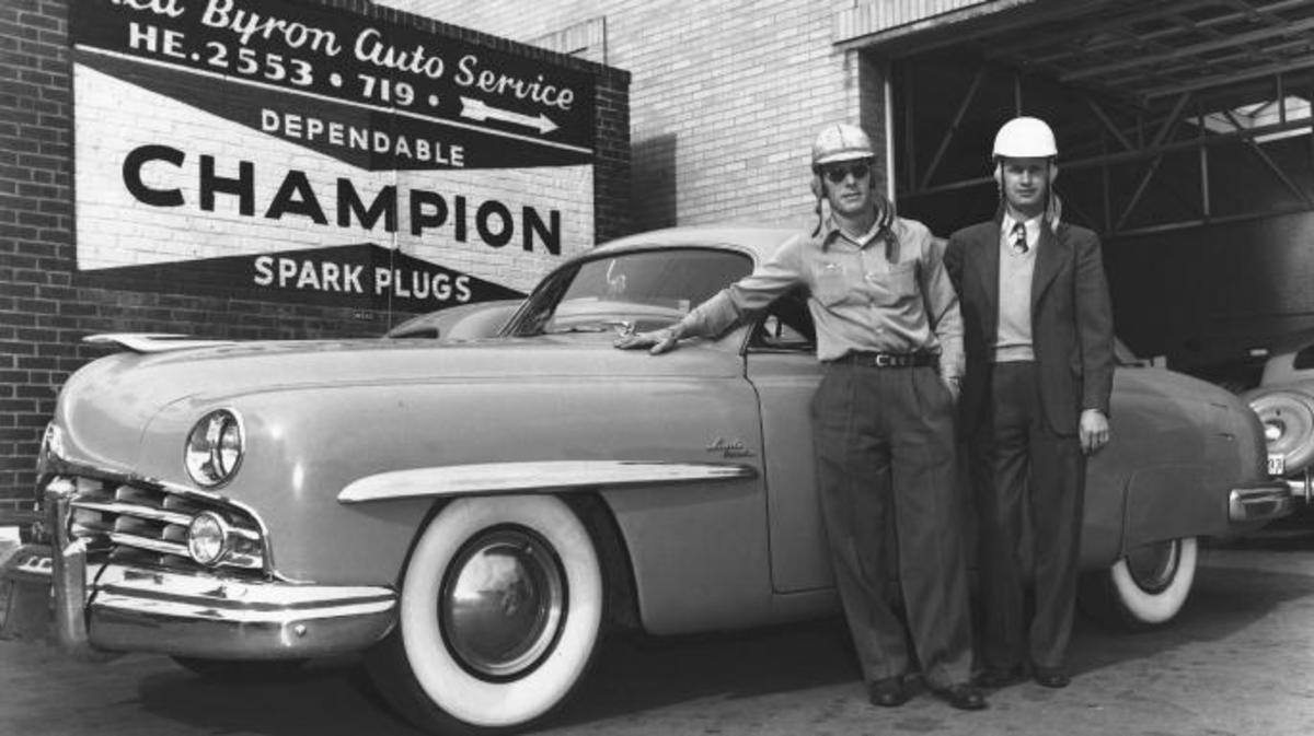 Red Byron (left) with his race car owner Raymond Parks in front of Byron's automotive garage, circa 1950s. (Credit: ISC Archives via Getty Images)