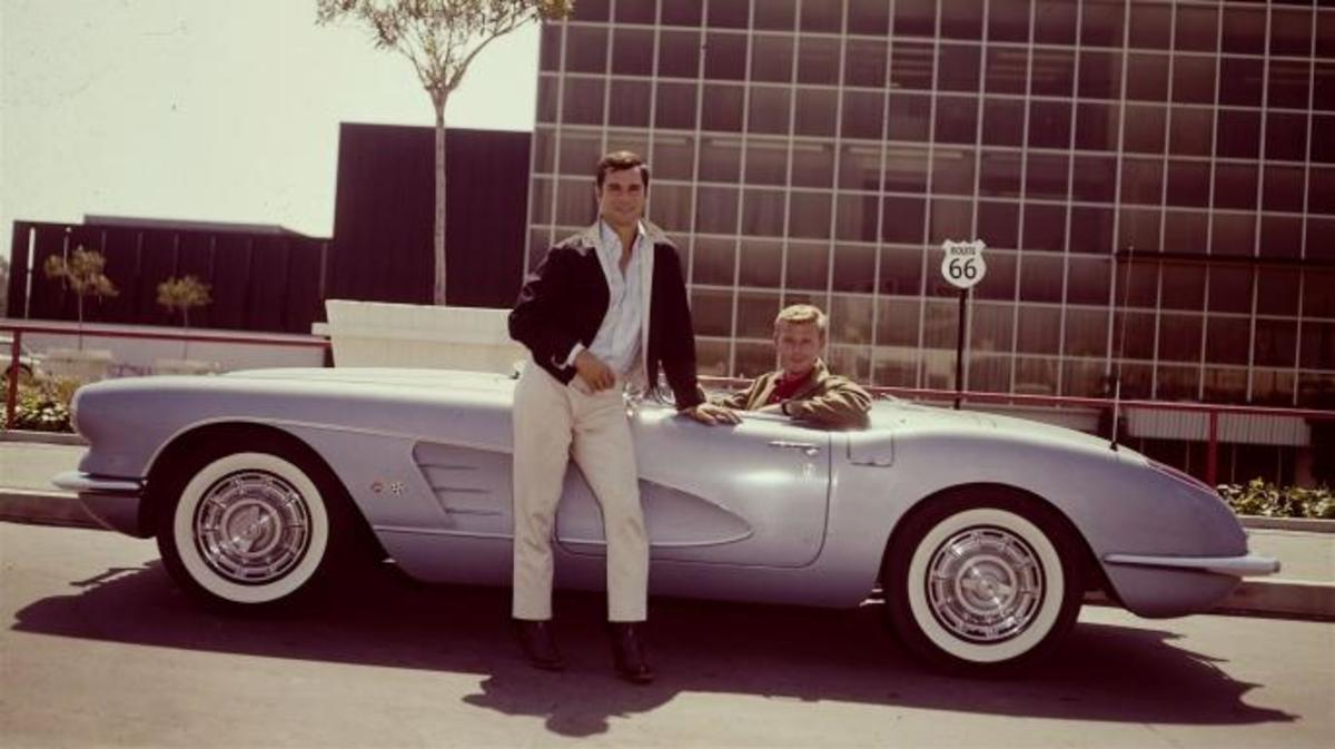 American actors George Maharis (standing) and Martin Milner pose with their blue Corvet from the television show 'Route 66.' (Credit: CBS Photo Archive/Getty Images)