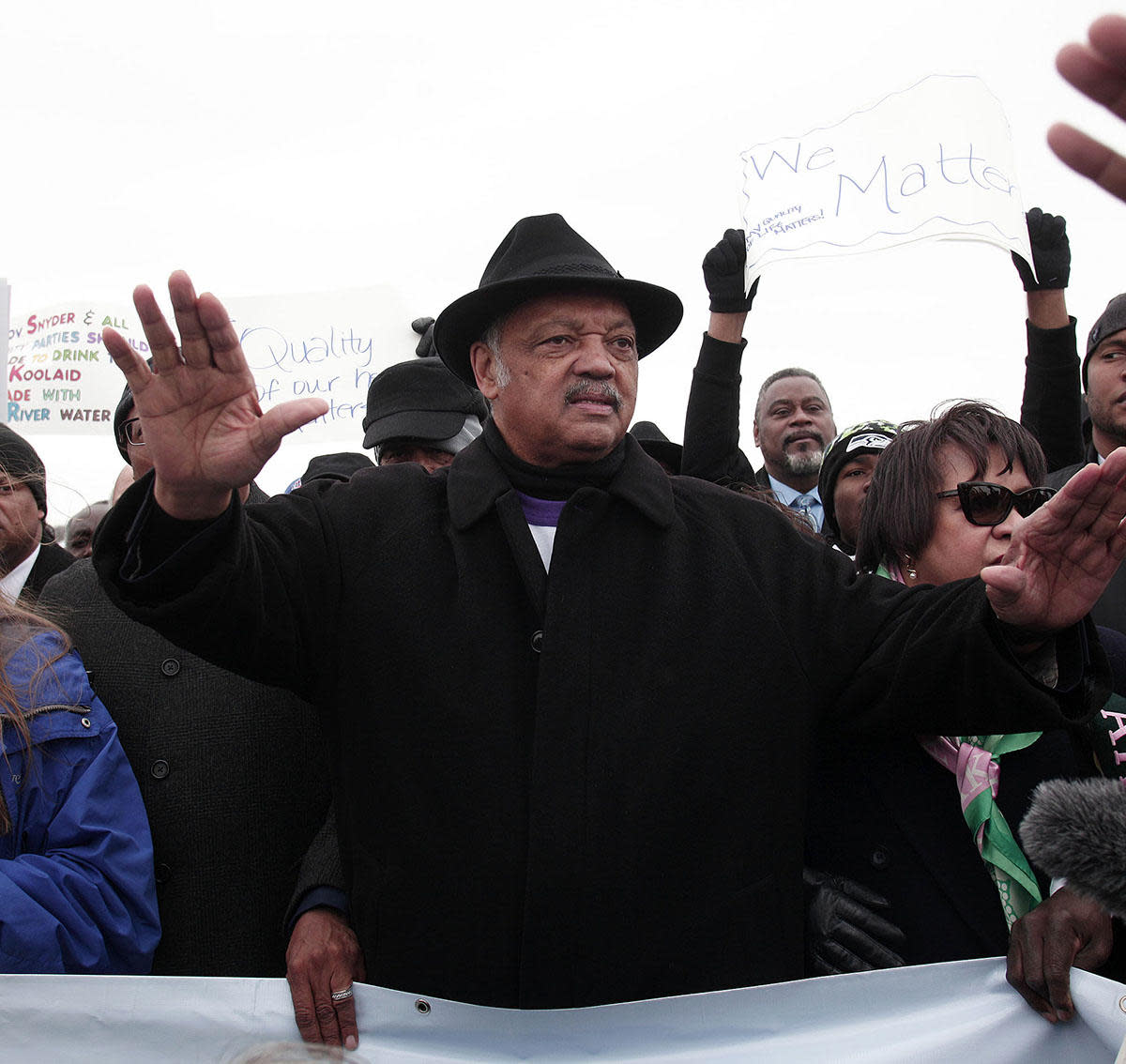 Jesse Jackson walking in a national mile-long march he helped organize to highlight the push for clean water in Flint, Michigan, 2016. (Credit: Bill Pugliano/Getty Images)