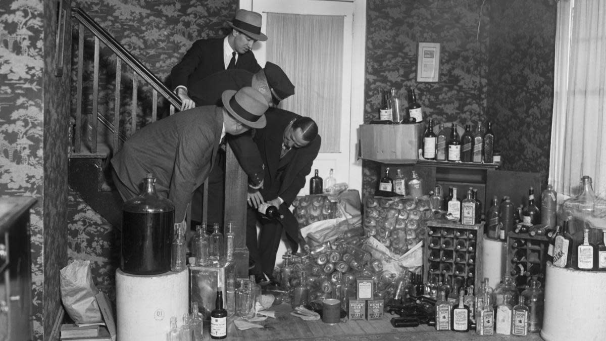 A prohibition-era raid in Long Island that uncovered around $20,000 worth of booze, 1930. (Credit: Bettmann Archive/Getty Images)