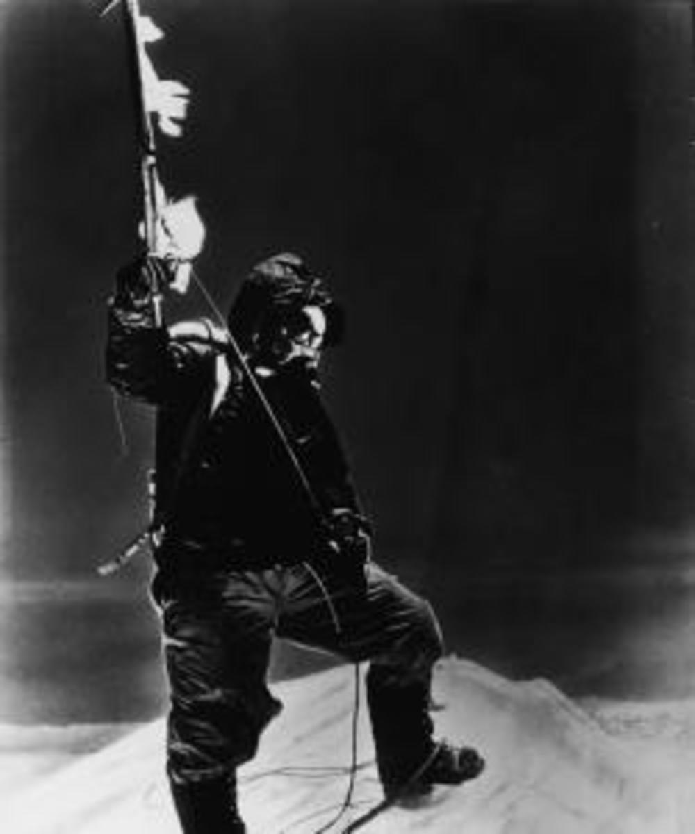 Tenzing Norgay  holds an ice axe at the summit of Mt. Everest, Nepal, on May 28, 1953. (Photo by Pictorial Parade/Getty Image