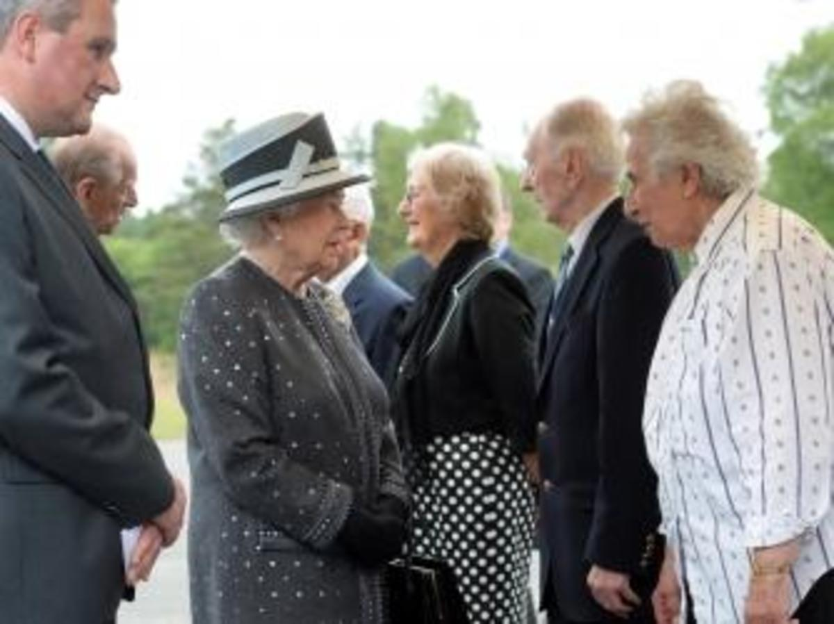 Queen Elizabeth II and Prince Philip talk with contemporary witnesses (LtoR) Doreen Levy, Captain Eric Brown and Anita Lasker-Wallfisch during a visit to the memorial site of former Nazi concentration camp Bergen-Belsen near Bergen. (Credit: JULIAN STRATENSCHULTE/AFP/Getty Images)