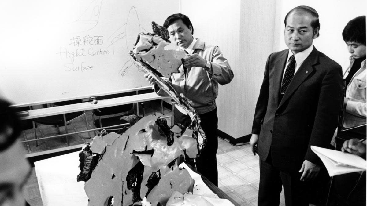 Korean Airlines equipment procurement section chief Suk Jin-Ku examining a piece of aircraft debris from Flight 007, at Wakkania Police station in Japan, September, 1983. (Credit: Mikami/AP Photo)