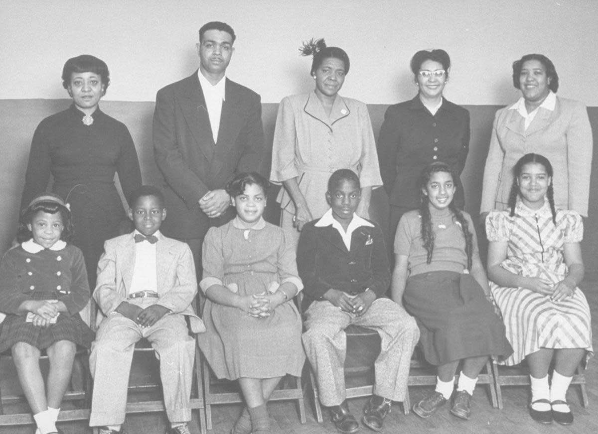 Portrait of the African-American students for whom the famous Brown vs Board of Education case was brought and their parents: (front row L-R) Vicki Henderson, Donald Henderson, Linda Brown, James Emanuel, Nancy Todd, and Katherine Carper; (back row L-R) Zelma Henderson, Oliver Brown, Sadie Emanuel, Lucinda Todd, & Lena Carper, Topeka, Kansas, 1953. (Photo by Carl Iwasaki/Time Life Pictures/Getty Images)