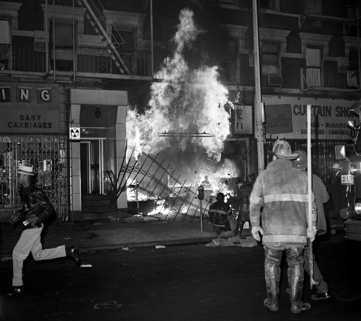 Firefighters battle a store fire set off during riots in Harlem, New York City, after the assassination of Martin Luther King Jr. (Credit: Bettmann Archive/Getty Images)
