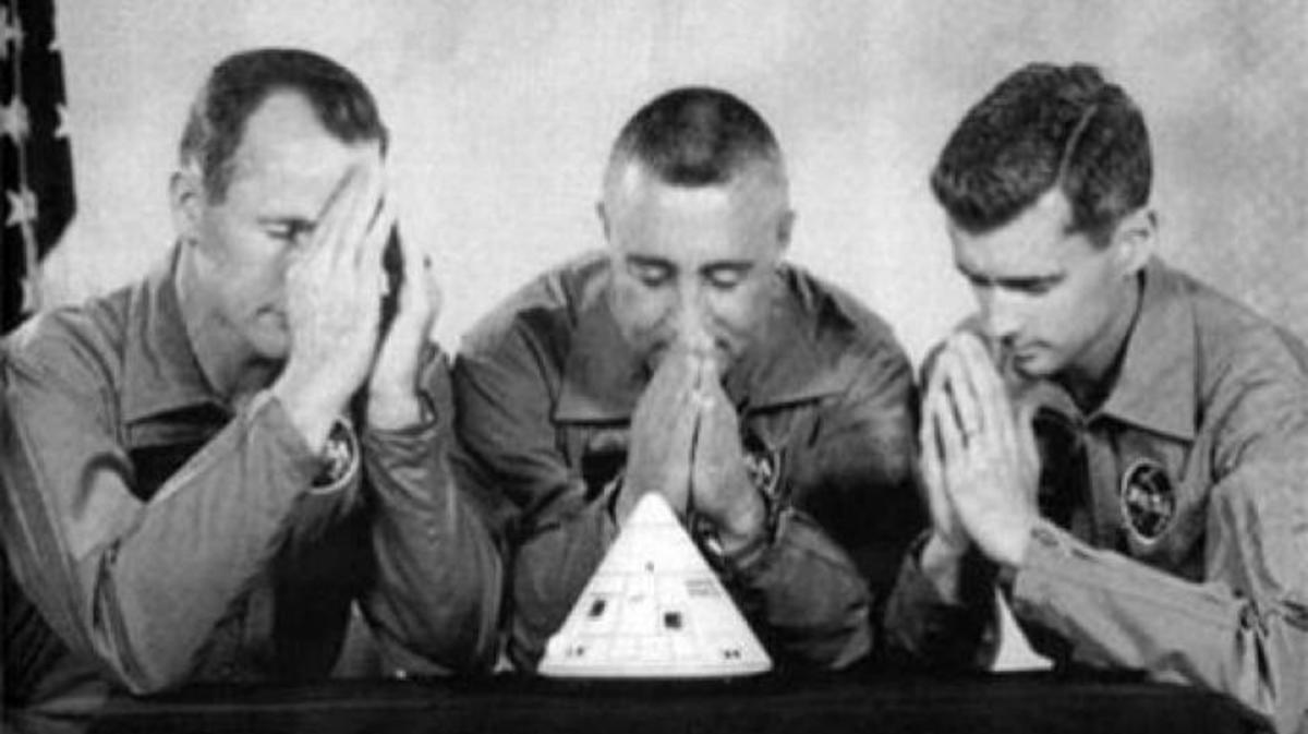 Gag photo of Apollo 1 crew in prayer.