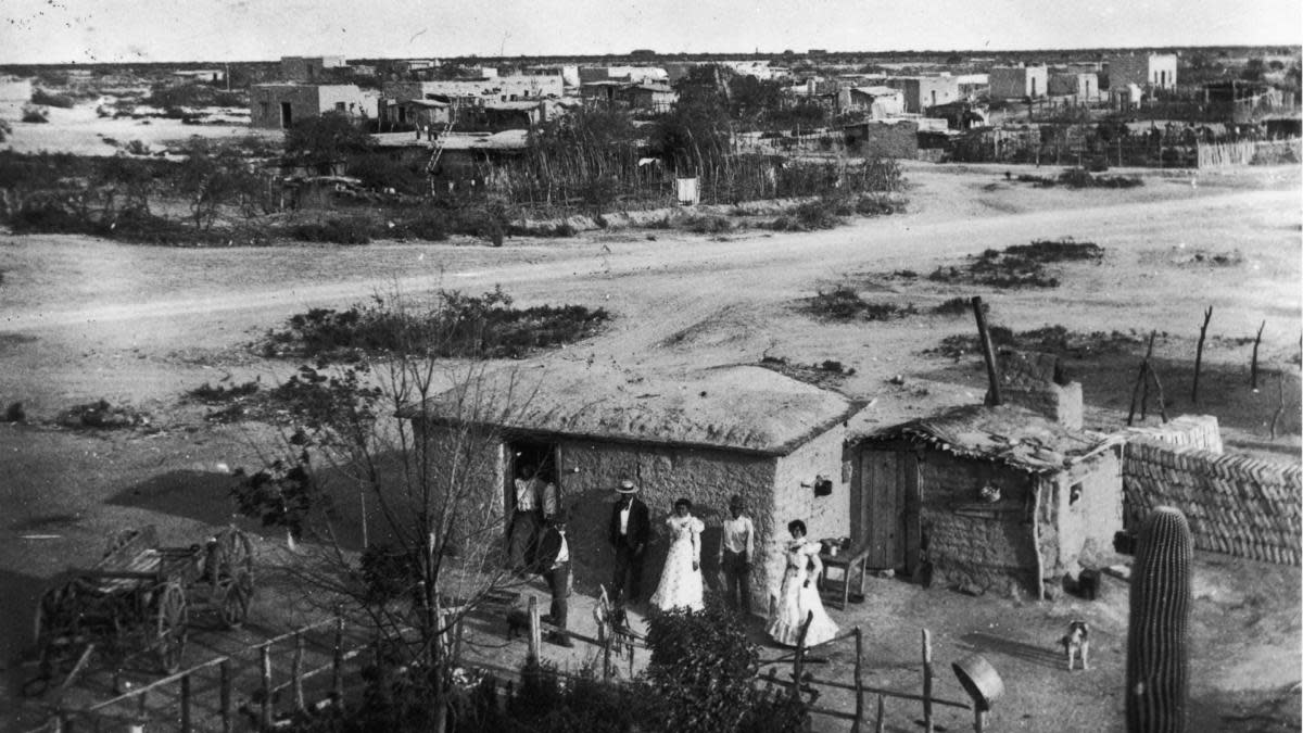 Immigrants outside of their home near the Mexico border in Tucson, Arizona circa 1890. (Credit: Fotosearch/Getty Images)
