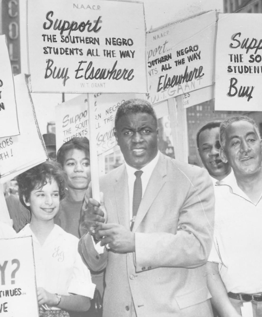 Jackie Robinson holding a sign in support of the NAACP and black students in the South, 1955. (Credit: Afro American Newspapers/Gado/Getty Images)