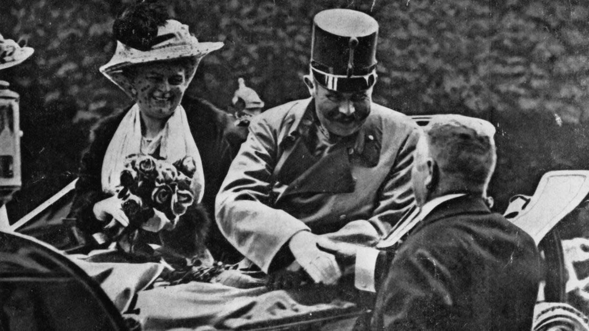 Franz Ferdinand, archduke of Austria, and his wife Sophie riding in an open carriage at Sarajevo shortly before their assassination. (Credit: Henry Guttmann/Getty Images)
