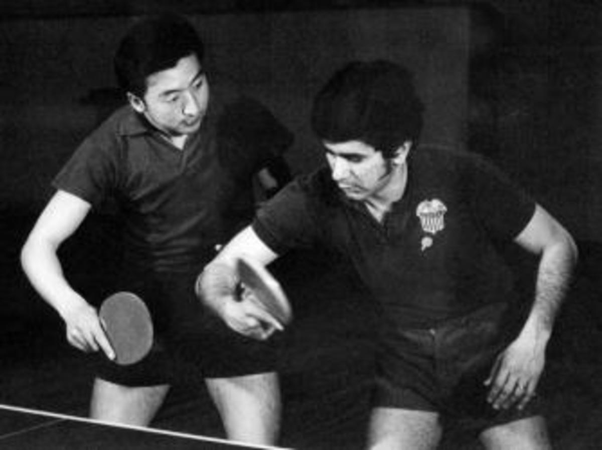 An American tennis table player trains with a Chinese tennis table player, in April, 1971 in Beijing, China. (Credit: AFP/Getty Images)