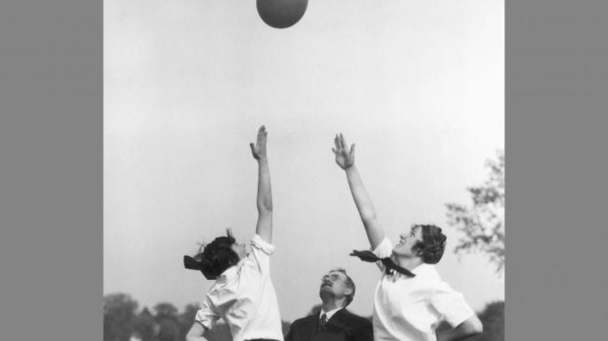 Dr. James Naismith teaching two women how to play basketball. (Credit: George Rinhart/Getty Images)