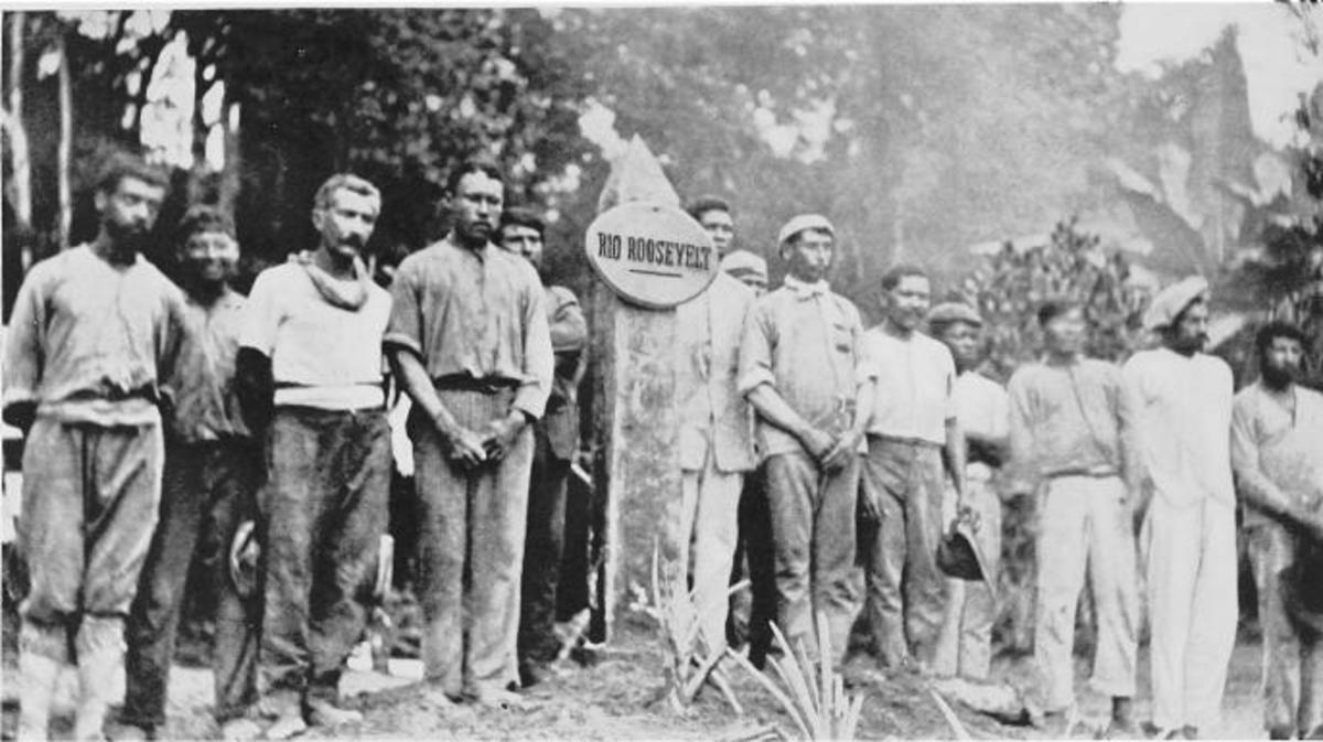 The expedition standing next to a Rio Roosevelt marker.