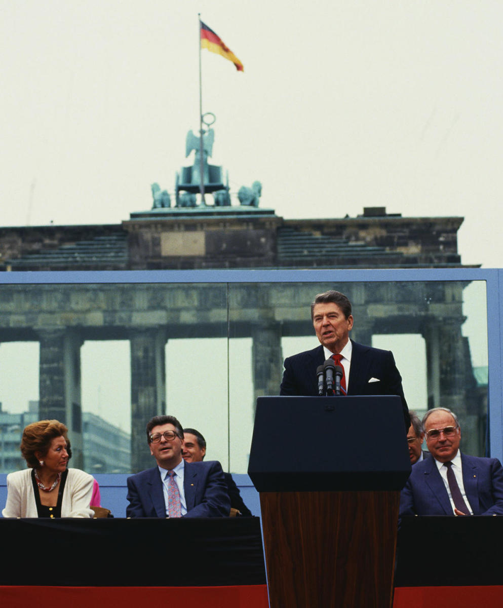 "President Ronald Reagan in front of the Brandenburg Gate in West Berlin on June 12, 1987 to make his famous speech saying, ""Mr. Gorbachev, tear down this wall."" (Credit: Wally McNamee/Corbis/Getty Images)"