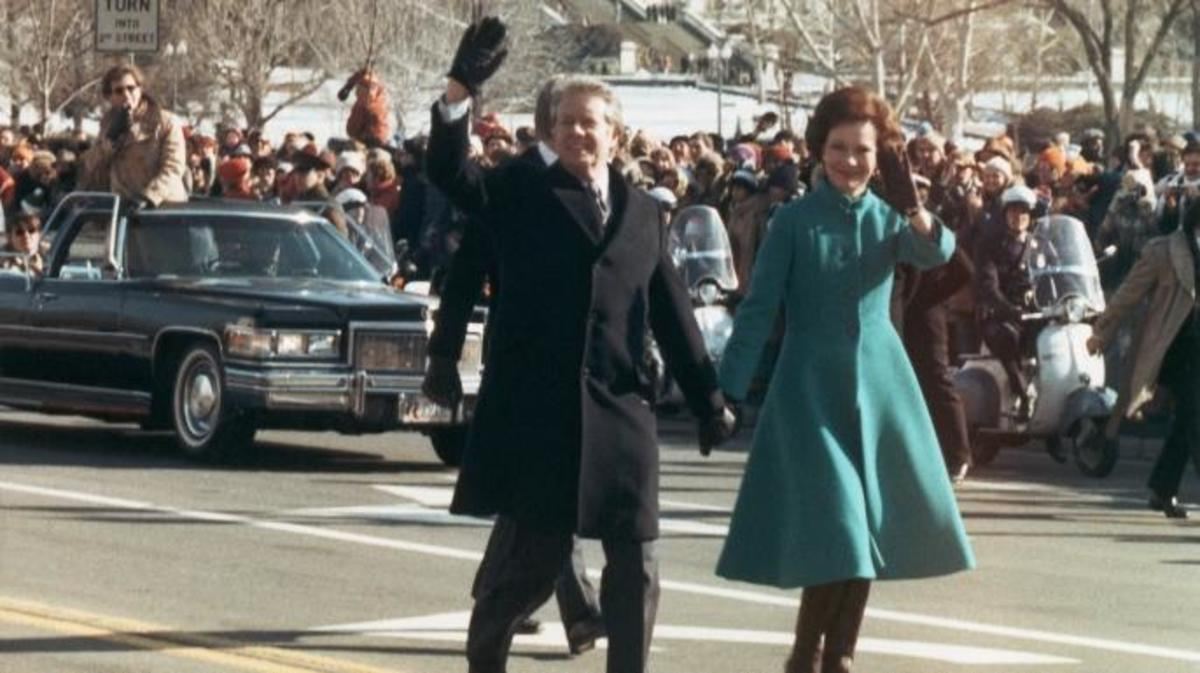 President Jimmy Carter and first lady Rosalynn Carter walk from the Capitol to the White House during his inauguration parade.