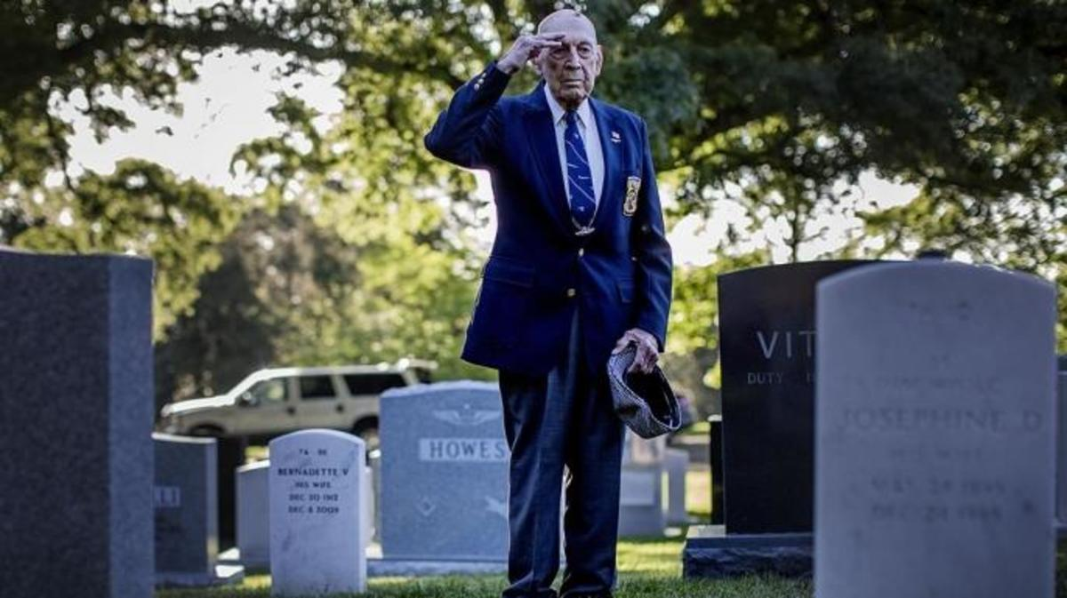 Lt. Col. Richard Cole visits the grave site of Lt. Col. Jimmy Doolittle at Arlington National Cemetery on May 23, 2014.