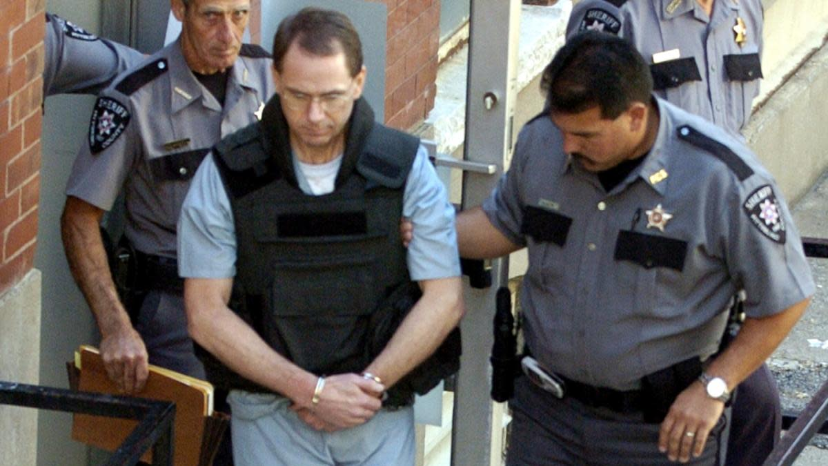 Terry Nichols leaves the Pittsburg County Courthouse after being sentenced to life without parole in 2004. Nichols was found guilty of all 161 counts of first degree murder in the bombing of the Alfred P. Murrah Federal Building April 19, 1995 in Oklahoma City. (Credit: Larry W. Smith/Getty Images)