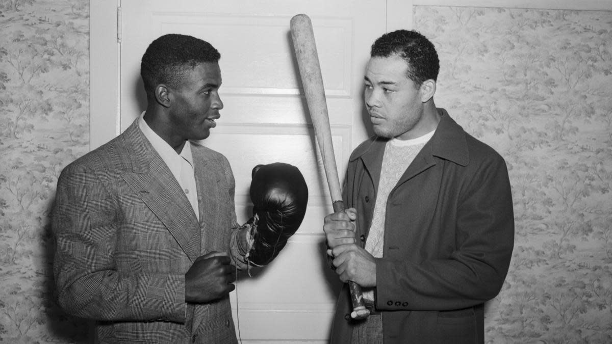 Jackie Robinson with heavyweight champion Joe Louis at Louis' Pompton Lake, NJ, training camp, 1946. (Credit: Bettmann Archive/Getty Images)