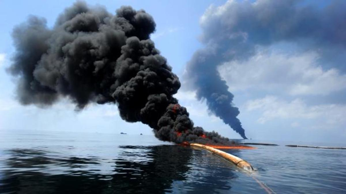 Dark clouds of smoke and fire emerge as oil burns during a controlled fire in the Gulf of Mexico. (Credit: Public Domain)