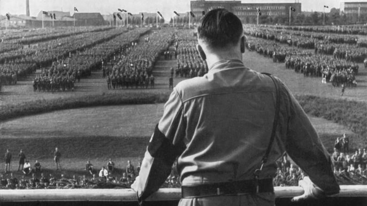 Adolf Hitler reviewing troops at a Nazi rally. (