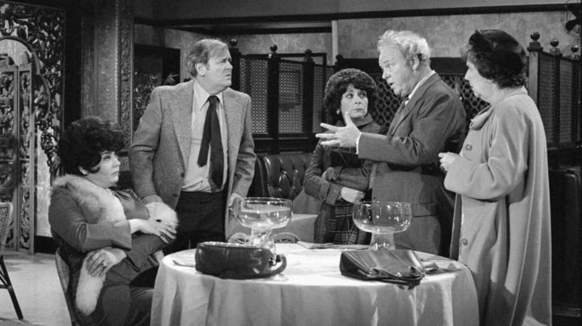 "All In The Family, episode ""Beverly Rides Again."" Featuring (from left)  Lori Shannon (as Beverly LaSalle), Eugene Roche (as Pinky), Phoebe Dorin (as Doris), Carroll O'Connor (as Archie Bunker) and Jean Stapleton (as Edith Bunker). (Credit: CBS/Getty Images)"