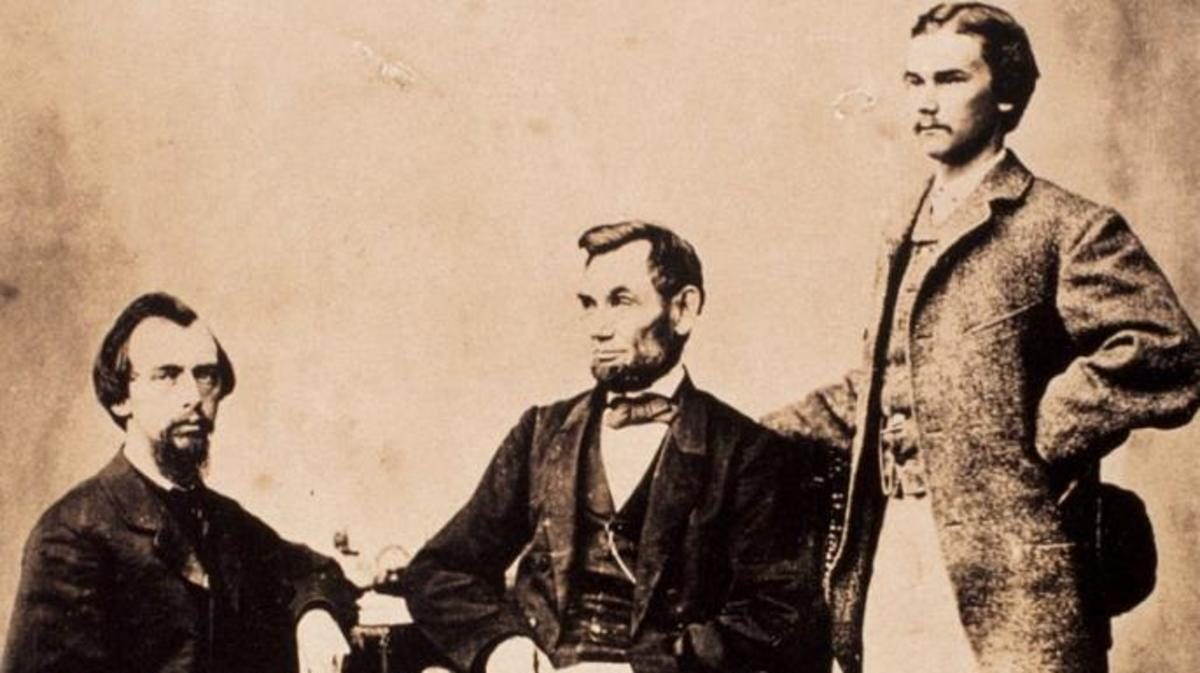 A studio portrait of Abraham Lincoln with his two personal secretaries, John Nicolay (left) and John Hay (right). (