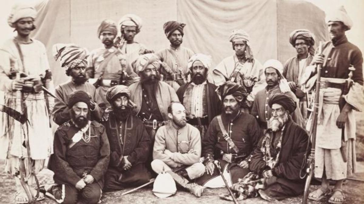 A photograph of Major Sir Pierre Louis Napoleon Cavagnari [1841-1879] sitting amongst a group of Afghan chieftains and army officers, taken in January 1879. Defeats at Ali Masjid and Peiwar Kotal had forced Afghanistan's new ruler, Amir Yaqub Khan [ d 1914], to accept a humiliating peace with the British which included accepting Cavagnari as envoy in Kabul. Widespread resentment in the country at the British presence led to an attack on the British residency in Kabul on 3 September 1879. Despite fighting bravely, Cavagnari and his small escort were killed. This, in turn, led the British to resume the war to avenge their deaths. (Credit: SSPL/Getty Images)