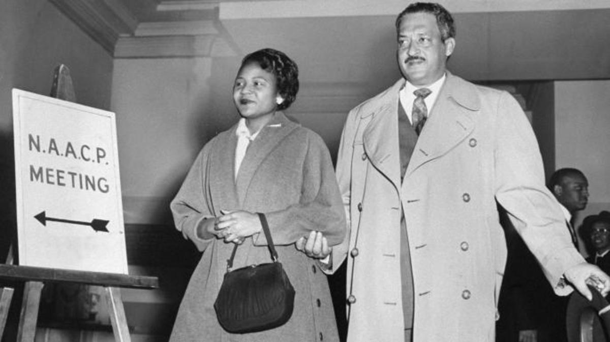 Autherine Lucy and Thurgood Marshall, her lawyer, entering the NAACP office for a press conference. (Credit: Al Pucci/NY Daily News Archive via Getty Images)