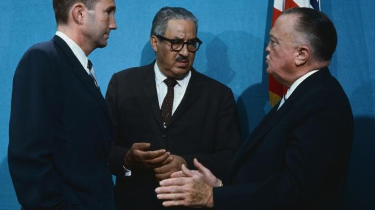 FBI Director J. Edgar Hoover, Supreme Court Justice Designate Thurgood Marshall, and Attorney General Ramsey Clark at the White House as President Johnson addressed member of the National Council on Crime and Delinquency, 1967. (Credit: Bettmann/Getty Images)