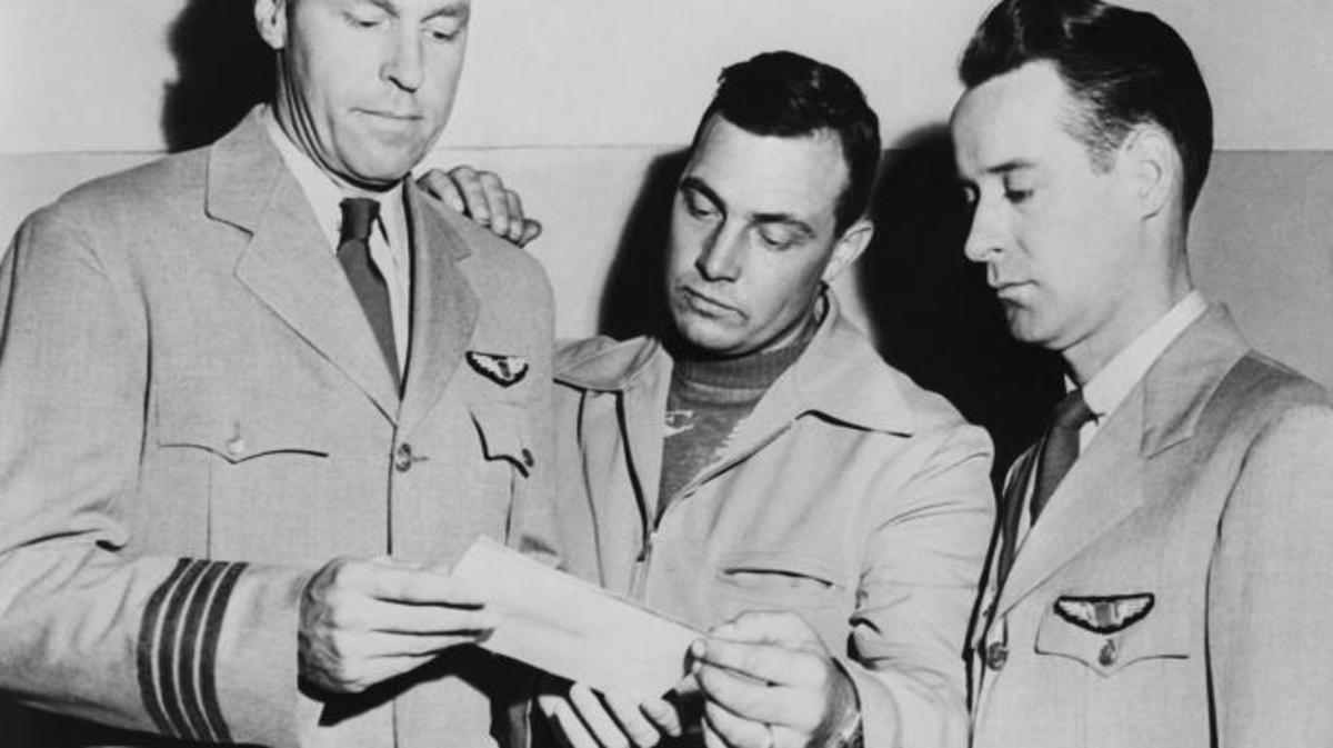 Pilots E.J. Smith, Kenneth Arnold, and Ralph E. Stevens look at a photo of an unidentified flying object which they sighted while en route to Seattle, Washington. (Credit: Bettmann/Getty Images)