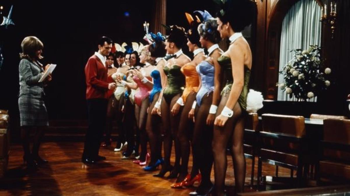 A group of Playboy Bunnies line up for inspection by Hugh Hefner. (Credit: Bettmann / Getty Images)