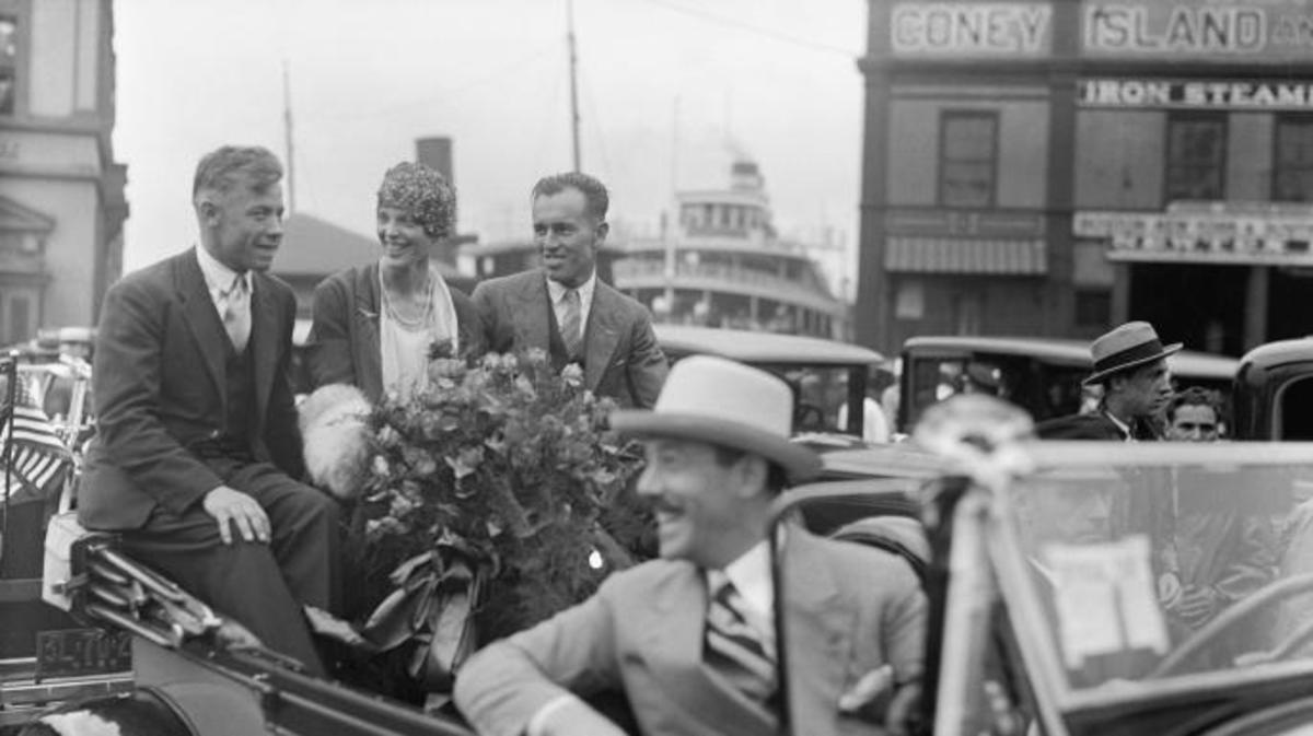 Amelia Earhart in a Parade reception after her Trans-Atlantic Flight in 1928 with pilots Wilmer Stultz and Luis Gordon. (Credit: Bettmann/Getty Images)