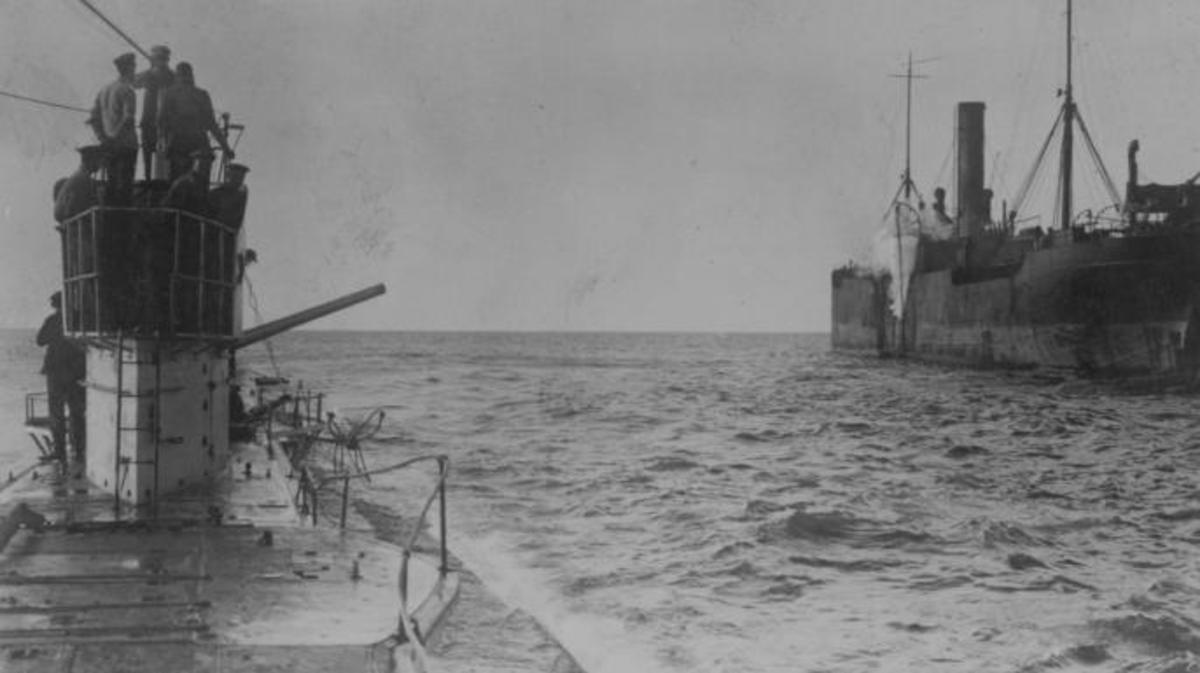 U-boat opening fire with a deck cannon, upon an allied merchant ship, circa 1915. (Credit: Hulton Archive/Getty Images)
