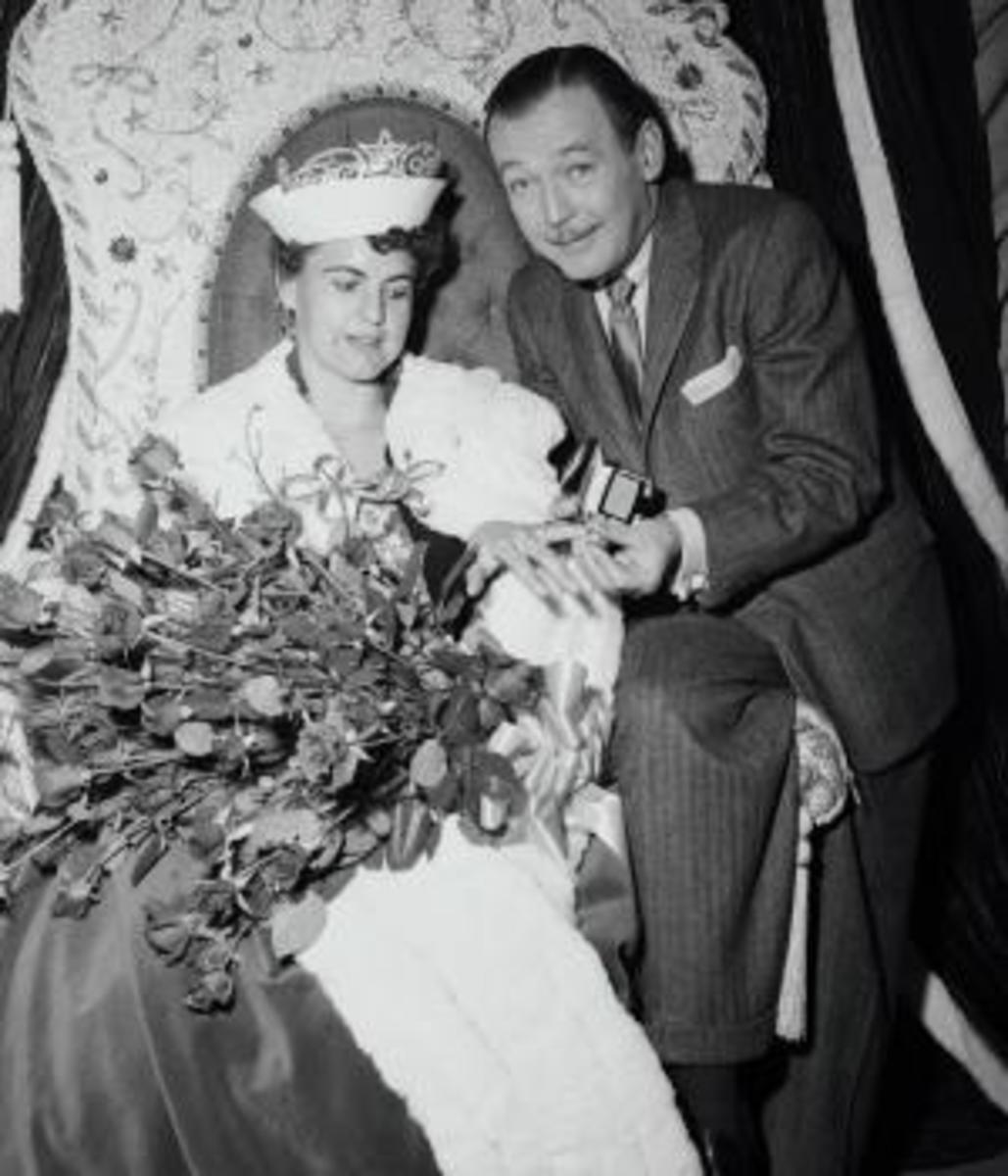 "Miss Wilhelmina Van Son, 27, elected ""Queen for a Day"" on the NBC-TV with emcee Jack Bailey. She won a flight to Florida along with an engagement-wedding ring ensemble. Once in Florida, a Navy helicopter would fly her aboard the USS Randolph, an aircraft carrier on which she would meet the 2,500-man crew in hopes of finding a husband. (Credit: Bettmann/Getty Images)"