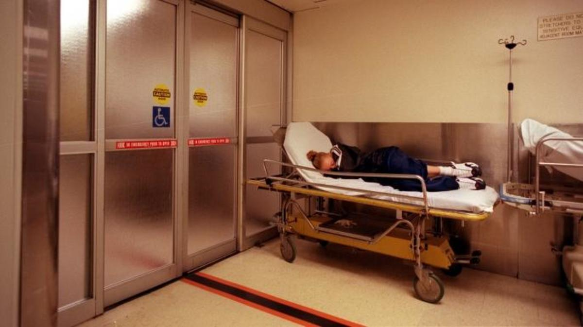 ––In the usually busy overcrowded County USC emergency room, a sick young lady lays in an empty hospital bed near the entry. (Credit: by Clarence Williams/Los Angeles Times via Getty Images)