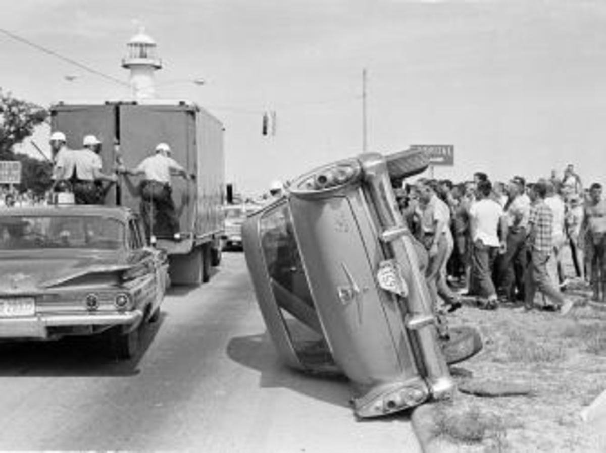 White men overturned this car belonging to black demonstrators during their arrest in Biloxi, Mississippi in June of 1963 while attempting to desegregate the Gulf Coast beach. Sixty-five people of both races were arrested in the attempt. (Credit: AP Photo/Jim Bourdier)