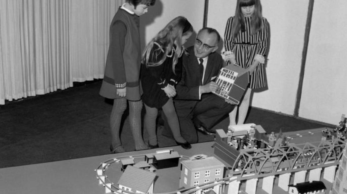 Godtfred Kirk Christiansen, President of the Lego company in Denmark, explains the Lego building toys to children, 1967. (Credit: PA Images via Getty Images)