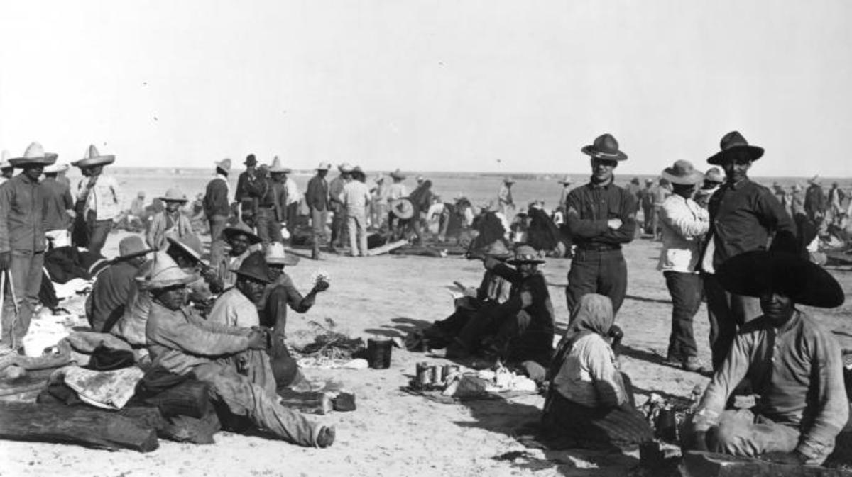 Refugees from Mexico at a camp on the desert in Fort Bliss, Texas during the Mexican Revolution. (Credit: OTA/Library of Congress/Corbis/VCG via Getty Images)