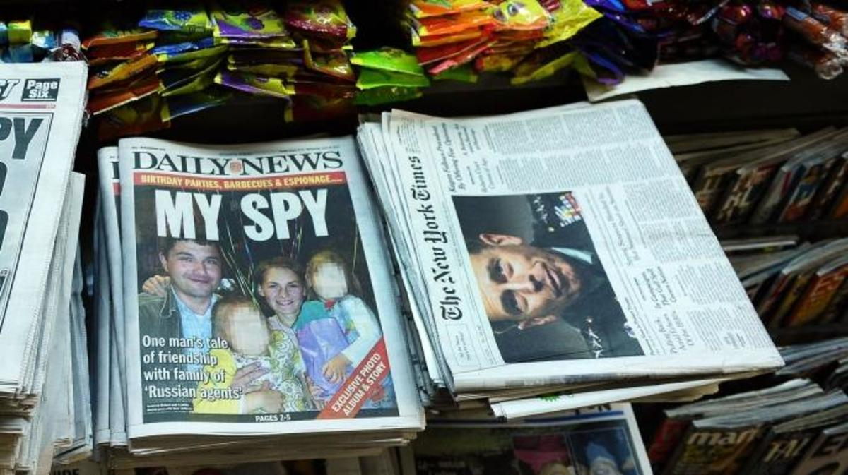 New York newspapers, one featuring Richard and Cynthia Murphy, at a news stand in New York, 2010. (Credit: Emmanuel Dunand/AFP/Getty Images)