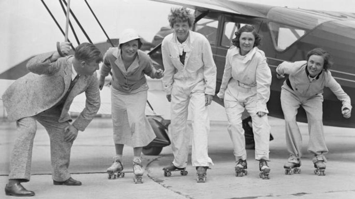"Flyers Amelia Earhart Putnam, Frances H. Marsalis, Elvy Kalep, and Betty Gillies rehearsing for a skating party that was held in a hangar by the ""Ninety Nines."" (Credit: Bettmann/Getty Images)"