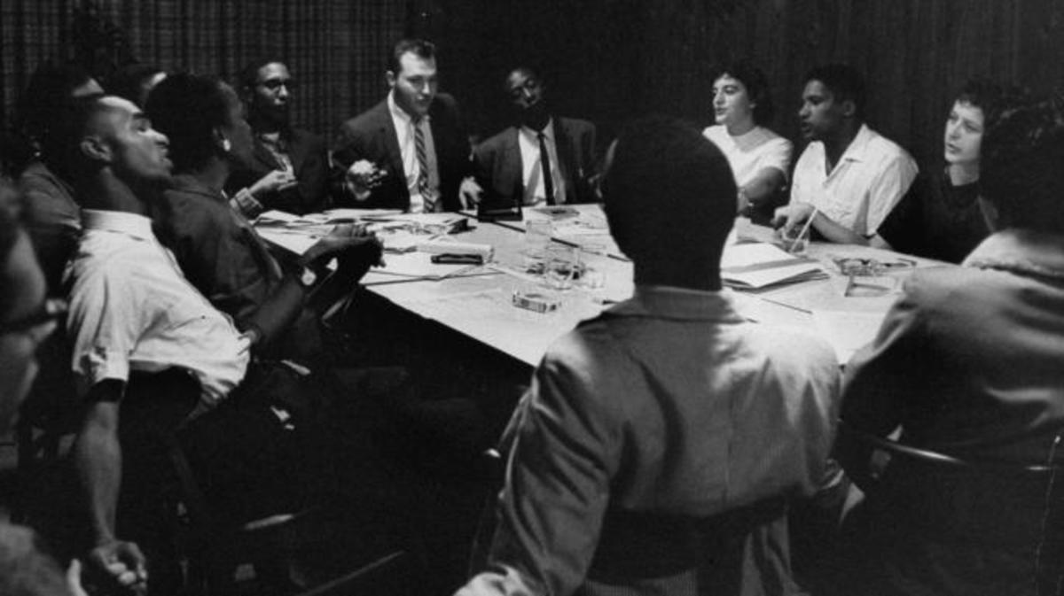 Student Non-violent Coordinating Committee planning freedom rides while singing 'We Will Overcome'. (Credit: Lynn Pelham/The LIFE Images Collection/Getty Images)
