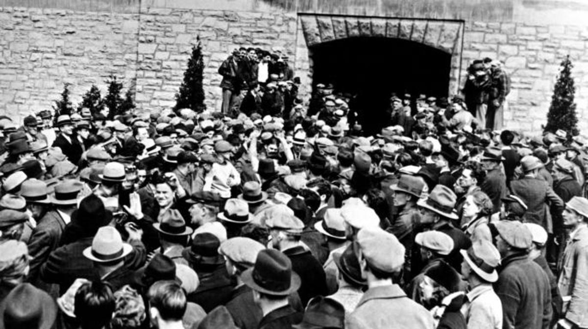 Mob of non-striking workers and local farmers allowing some of the 600 striking leave the factory peacefully with their arms raised. More belligerent strikers were ejected by the mob of people, with 25 injured, some of which were hospitalized. (Credit: Everett Collection Historical/Alamy Stock Photo)