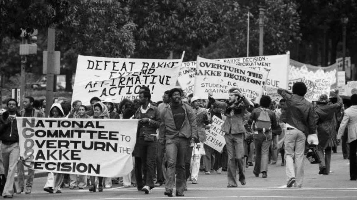 Demonstrators sponsored by the National Committee to Overturn the Bakke Decision march along Pennsylvania Avenue in Washington, 1977. (Credit: Charles Tasnadi/AP Photo)