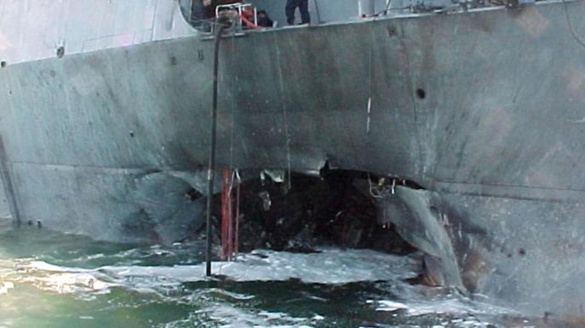 A gaping hole mars the port side of the USS Cole after a terrorist bomb exploded and killed 17 U.S. sailors and injured approximately 36 others on October 12, 2000, in the port of Aden, Yemen.