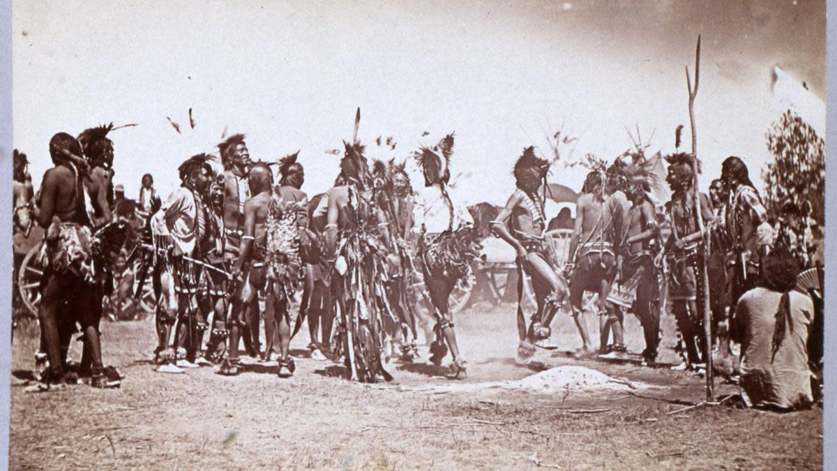 At the 10-year memorial of the Battle of Little Bighorn, unidentified Lakota Sioux dance in commemoration of their victory over teh United States 7th Cavalry Regiment (under General George Custer), Montana, 1886. The photograph was taken by S.T. Fansler, at the battlefield's dedication ceremony as a national monument. (Photo by Transcendental Graphics/Getty Images)